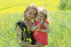 Mother and daughter in rapeseed field Royalty Free Stock Photography