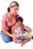 Mother and daughter reading.