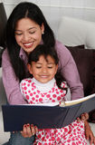 A mother and daughter reading book Stock Image