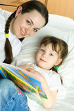 Mother and daughter reading a book Royalty Free Stock Image