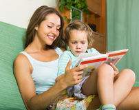 Mother and daughter reading book Stock Image