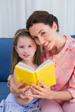 Mother and daughter reading book Stock Images
