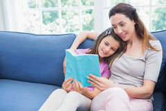 Mother and daughter reading a book Stock Image