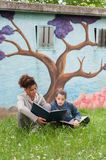 Mother and daughter reading a book Royalty Free Stock Photos
