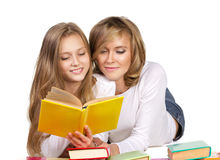 Mother and daughter reading books Royalty Free Stock Image