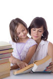 Mother and daughter reading books Stock Photo