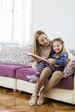 Mother and daughter reading in the room Royalty Free Stock Photography