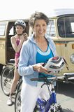 Mother And Daughter Ready To Go For Cycle Ride Royalty Free Stock Photos
