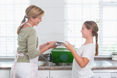 Mother and daughter recycling together Stock Photography