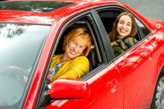 Mother with daughter in the red car Royalty Free Stock Photo
