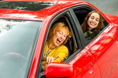 Mother with daughter in the red car Royalty Free Stock Photography