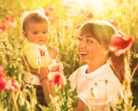 Mother and daughter with red poppies Stock Photo