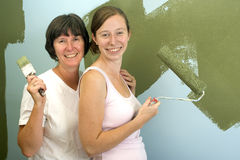 Mother and Daughter redecorating. Stock Photography