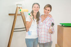 Mother and daughter redecorating a room Royalty Free Stock Images