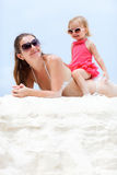 Mother and daughter relaxing at beach Royalty Free Stock Photography