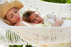 Mother And Daughter Relaxing In Beach Hammock Royalty Free Stock Image