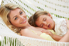 Mother And Daughter Relaxing In Beach Hammock Stock Image