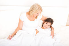 Mother with daughter relaxing in bed Royalty Free Stock Image