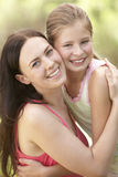 Mother And Daughter Relaxing In Countryside Royalty Free Stock Images