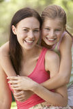 Mother And Daughter Relaxing In Countryside Royalty Free Stock Photography