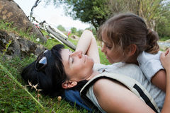 Mother and daughter relaxing on a grass Stock Images