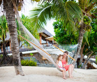 Mother and daughter relaxing in hammock Stock Photos