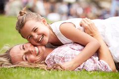 Mother And Daughter Relaxing At Outdoor Summer Event Royalty Free Stock Image