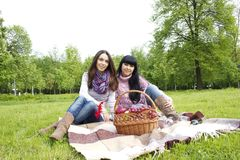 Mother and daughter relaxing outdoors Stock Photography