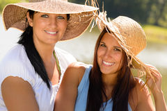 Mother and daughter relaxing outdoors summer teen Stock Photo