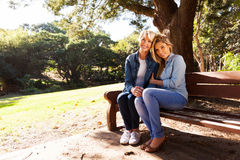 Mother daughter relaxing park bench Royalty Free Stock Photography