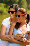 Mother and daughter relaxing in park smiling Royalty Free Stock Photography