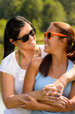 Mother and daughter relaxing in park smiling Royalty Free Stock Image
