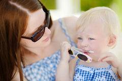 Mother and daughter relaxing in restaurant Royalty Free Stock Images