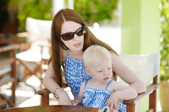 Mother and daughter relaxing in restaurant Royalty Free Stock Image