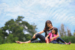 Mother and daughter relaxing sitting Royalty Free Stock Images