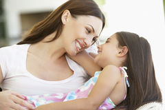 Mother And Daughter Relaxing Together At Home Stock Images