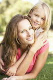 Mother And Daughter Relaxing Together In Park royalty free stock images