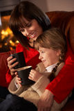 Mother And Daughter Relaxing Watching TV By Cosy Royalty Free Stock Photos