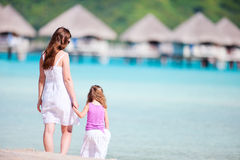 Mother and daughter at resort beach Royalty Free Stock Photo