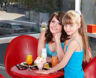 Mother and daughter in restaurant. Stock Images