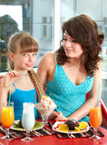 Mother and daughter in restaurant. Royalty Free Stock Photography