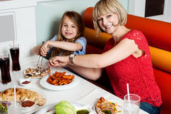 Mother and daughter in a restaurant Stock Photo