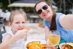 Mother and daughter at restaurant Stock Image