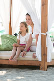 Mother and daughter resting on the beach Royalty Free Stock Photography