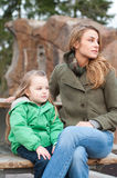 Mother and daughter resting on a bench Stock Photo