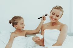 Mother With Daughter Are Resting. Spa Concept. Young Mother With Daughter Are Resting. Spa Concept. Relaxing Together. Holiday Leisure. Doing A Make Up. Time To stock photography