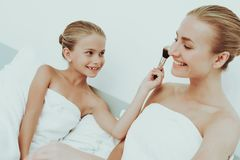 Mother With Daughter Are Resting. Spa Concept. Young Mother With Daughter Are Resting. Spa Concept. Relaxing Together. Holiday Leisure. Doing A Make Up. Time To royalty free stock photo