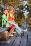 Mother and daughter resting after walk Stock Photos