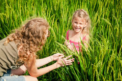 Mother and daughter on the rice paddies Royalty Free Stock Image