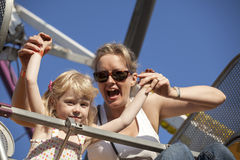 Mother and Daughter on a Ride at the Amusement Park Royalty Free Stock Photo
